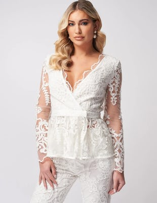 Ivory Lace Embroidered Wrap Top with Ruffled Peplum Hem