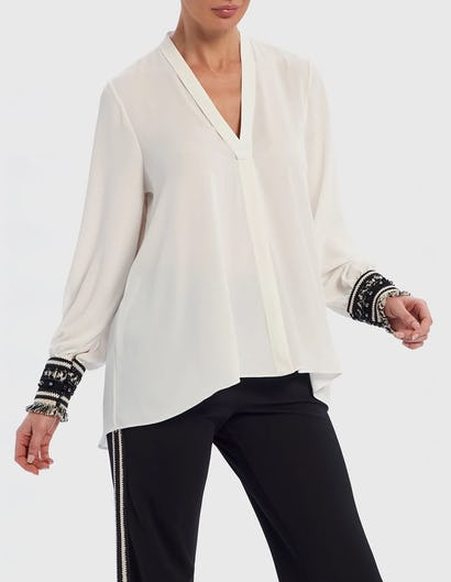 White Blouse with Monochrome Tasseled Cuffs